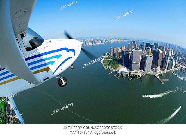 A light plane Cessna 172 flying over Lower Manhattan and Hudson river on the special VFR uncontrolled airspace , New York city, USA