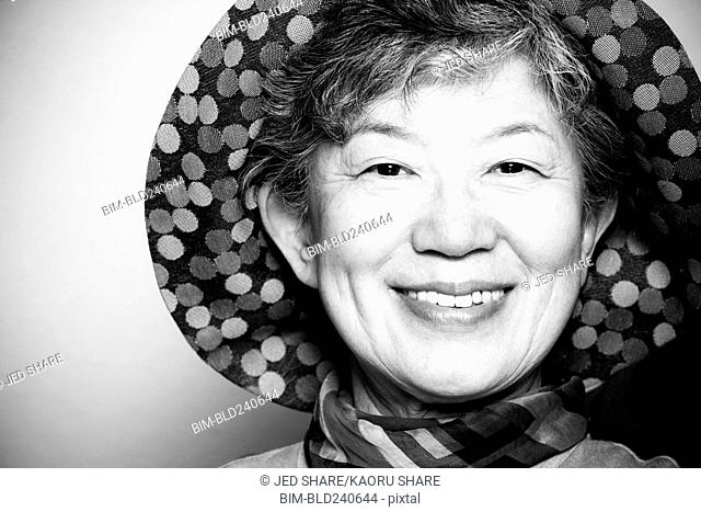 Portrait of smiling Japanese woman wearing hat