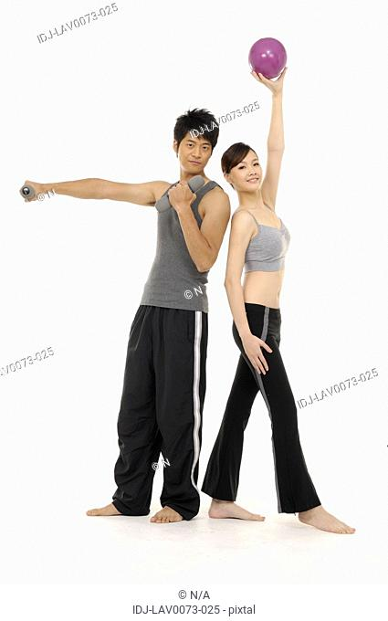 couple doing exercise indoors