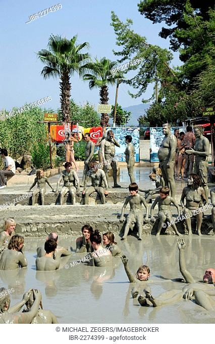 People taking a mud bath, spa on Lake Koycegiz, Sultaniye, near Dalyan, Mugla Province, Turkey, Asia Minor