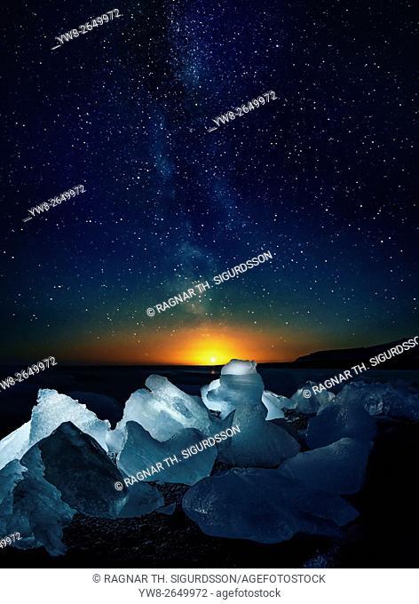 Milky way, stars and icebergs Breidamerkursandur. Icebergs come from the Jokulsarlon Glacial Lagoon, Breidamerkurjokull Glacier, Vatnajokull Ice Cap, Iceland