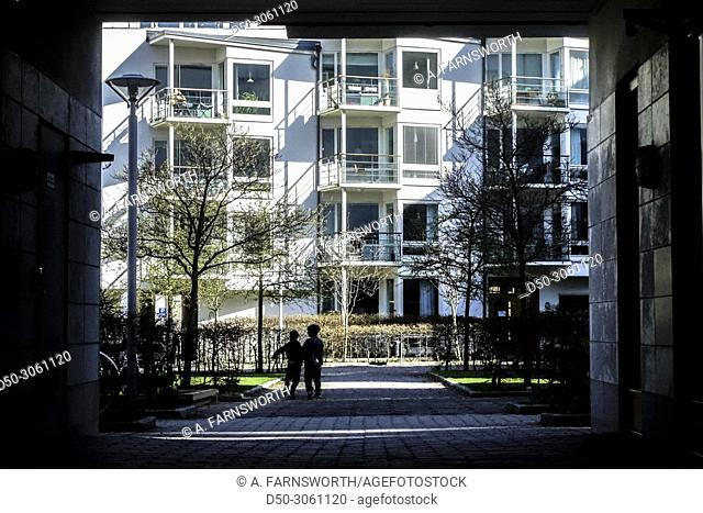 Stockholm, Sweden Pedestrians in the neighborhood of Hammarby hamnen, a modern neighborhood built in the last ten years known for its ecological profile