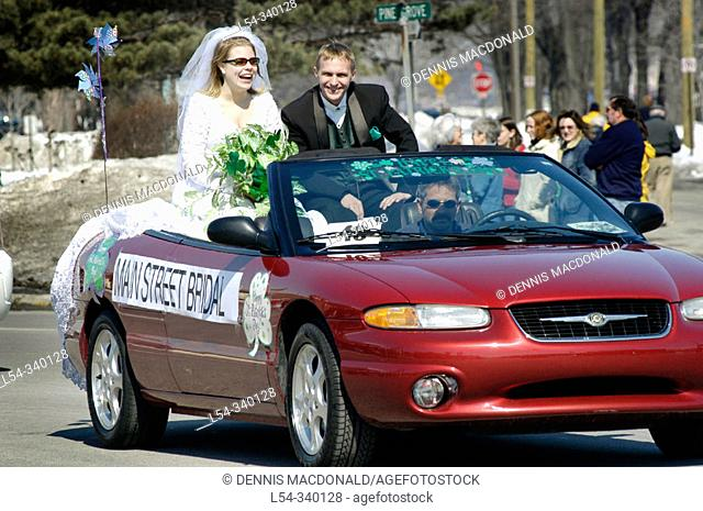 Bride and groom ride in convertable