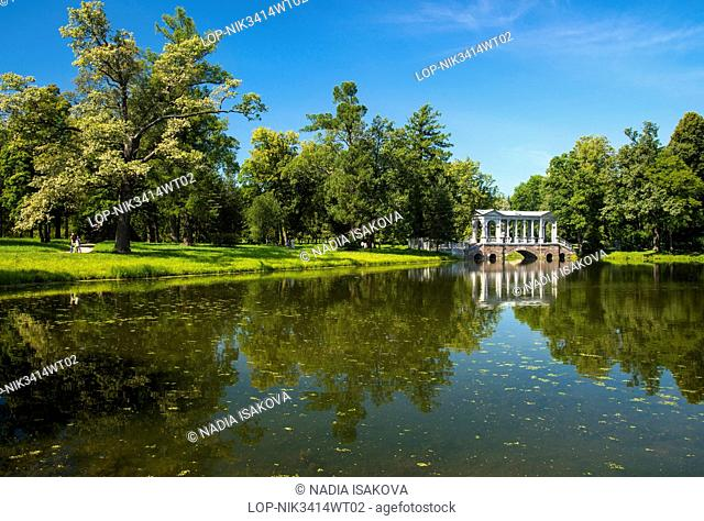 Russia, Saint Petersburg, Pushkin. Marble Bridge reflected in the Great Pond at Catherine Park,