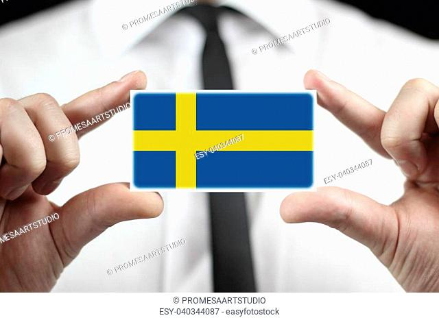 Businessman holding a business card with a Sweden Flag