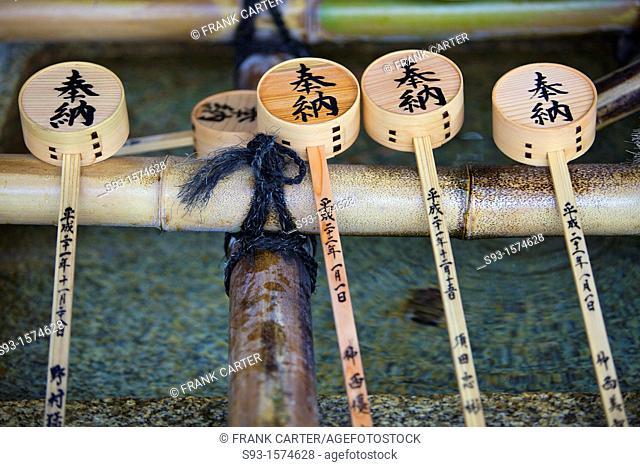 Bamboo drinking ladles at a water basin at Yasaka Shrine