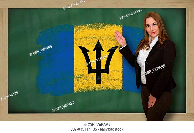 Successful, beautiful and confident woman showing flag of barbados on blackboard for marketing research, presentation and tourist advertising