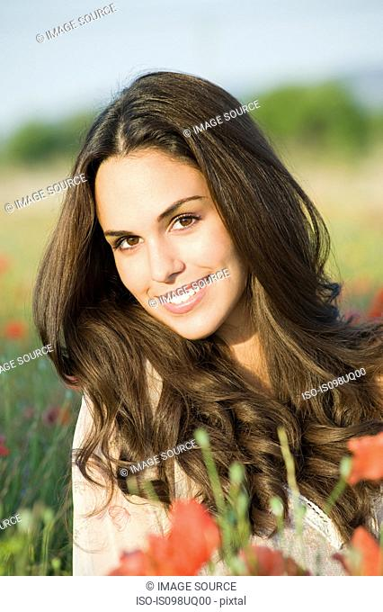 Portrait of young brunette woman outdoors