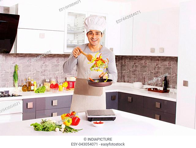Portrait of a man cooking