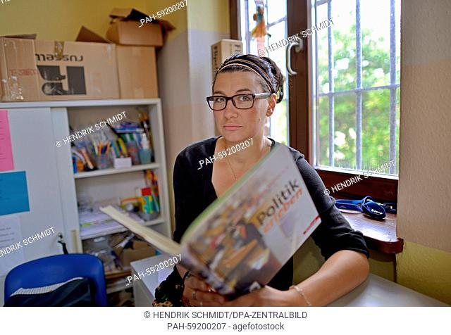 Student teacher Julia Rueprich teaches social studies at a juvenile detention centre in Halle, Germany, 27 May 2015. She has been teaching there once a week...