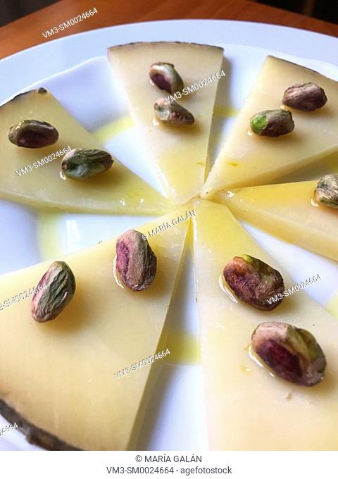 Manchego cheese with pistachios and olive oli. Spain