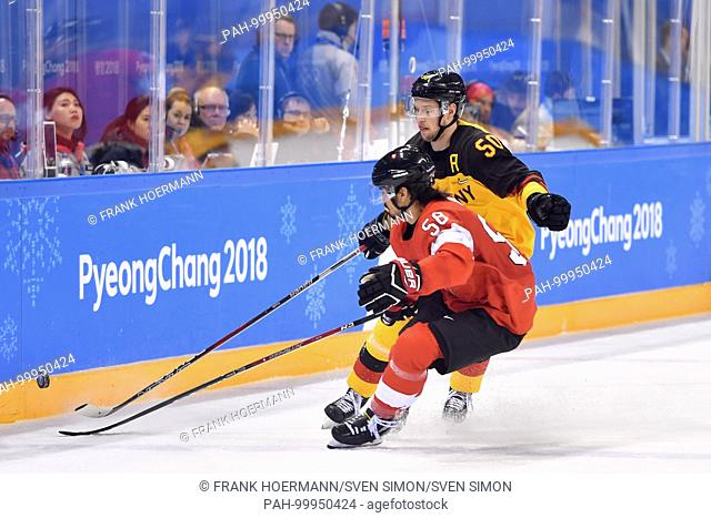 Patrick HAGER, GER, Aktion, duels with Eric BLUM (SUI), Aktion,.Schweiz - Germany SUI - GER 1:2 n.V., OT, Overtime, .Play Offs Qualifications, Game 22