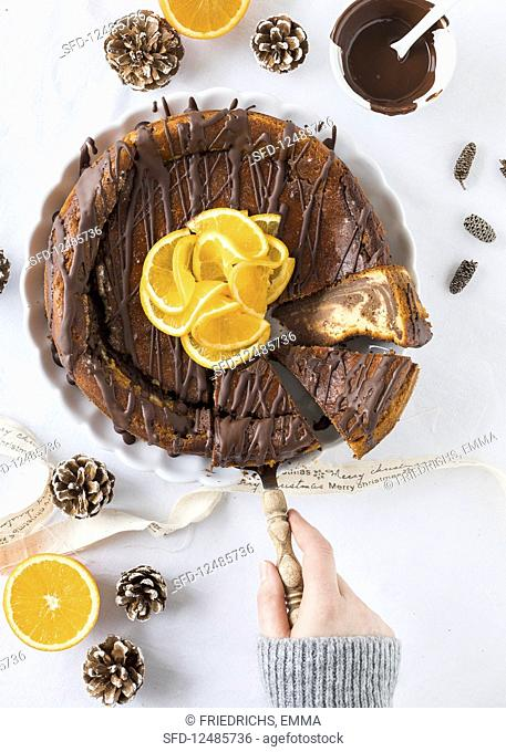 Chocolate orange cheesecake being sliced