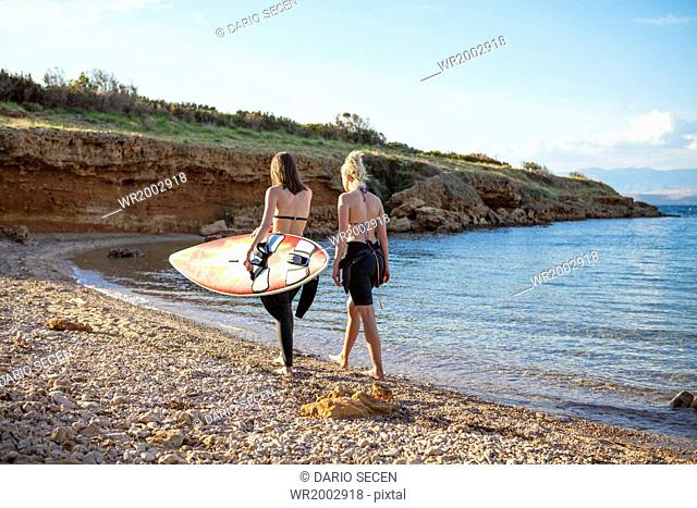 Female surfers on beach