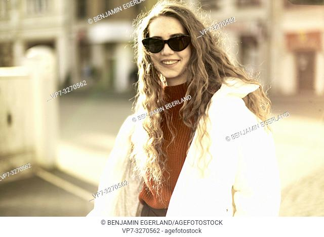 young woman, wearing sunglasses, in city Cottbus, Brandenburg, Germany