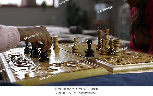 Chess game player making black rook move