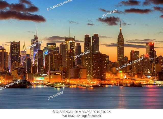 The Manhattan skyline in New York City during morning twilight as viewed over the Hudson River looking east from New Jersey
