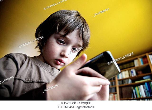 Young boy playing with an mp3 player