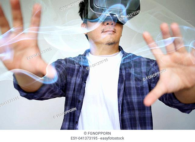 Young man wearing virtual reality glasses and touching on virtual screen. Virtual reality concept