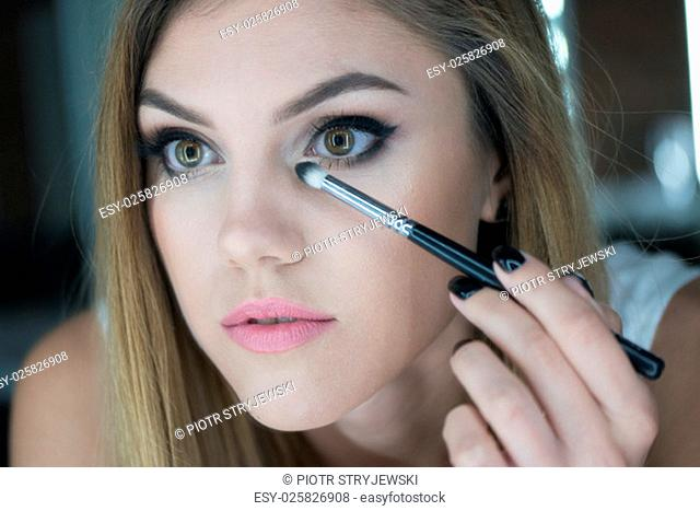 Close Up of Woman Applying Make Up mascara