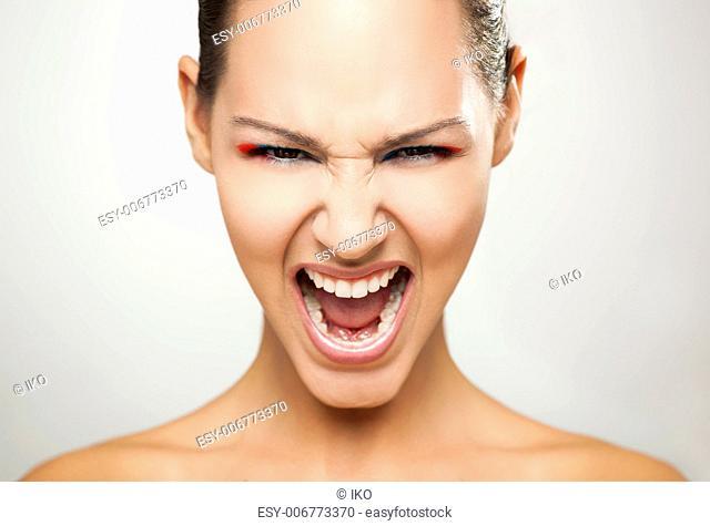 fashion portrait of a beautiful young woman shouting