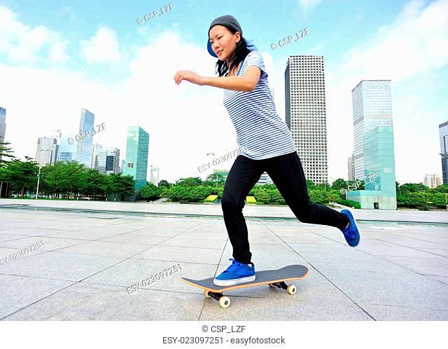 woman skateboarder skateboarding