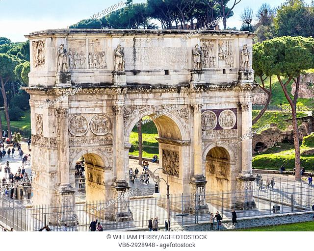 Tourists Arch of Constantine Rome Italy Arch built in 315 AD to celebrate Emperor Constantine's victory in 312 over co-emperor Maxenntius