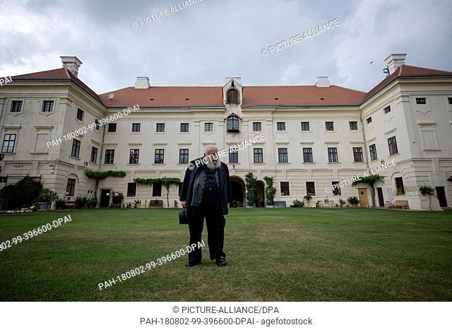 01 August 2018, Austria, Prinzendorf an der Zaya: The Austrian painter and action artist Hermann Nitsch stands in front of his castle