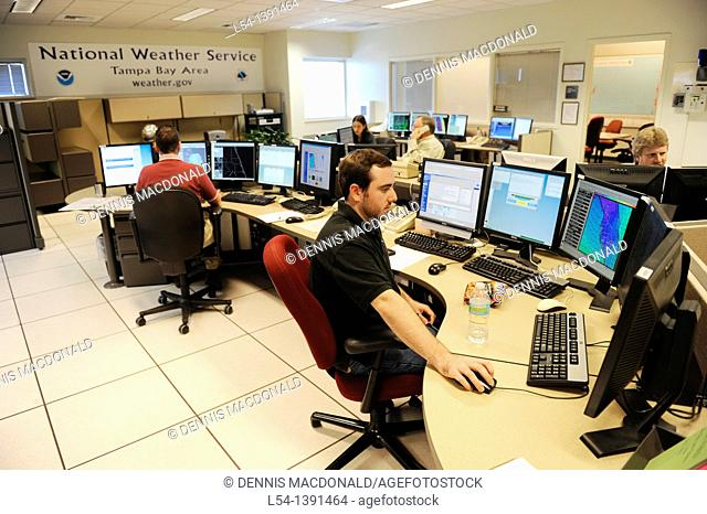 Meteorologist in Work Area in Doppler Radar National Oceanic and Atmospheric Administration NOAA National Weather Service Station Ruskin Florida Tampa...