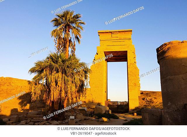 Sunset over a monumental gate in Karkak temple, Luxor, Egypt