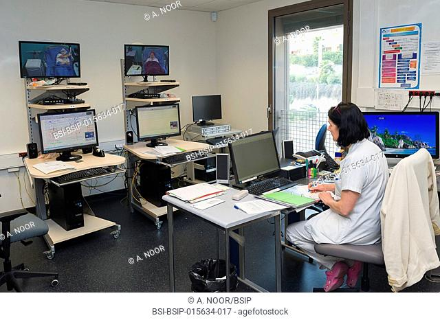 Reportage in the epileptology unit in Nice Hospital, France. A nurse in the control room. The control room is used during long-term EEGs
