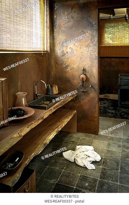 Modern bathroom with corten steel wall cladding