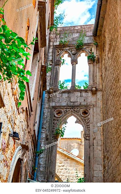 Old ruins with venetian windows in Old town of Kotor, Montenegro