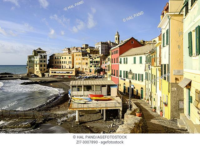 cityscape of historical traditional houses around little gulf with old houses near the beach, shot on a sunny winter day at Bogliasco, Genova, Italy