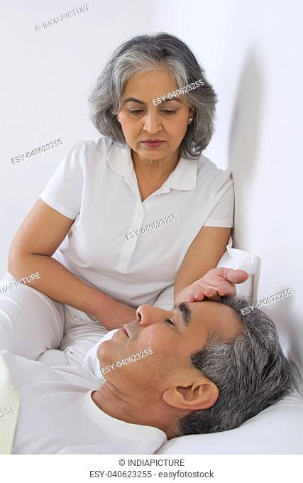 Wife checking husband's fever