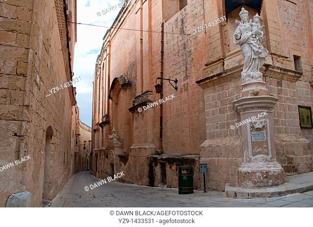Triq San Pietru with the statue of the Madonna and Child on the Carmelite Church, Mdina, Malta