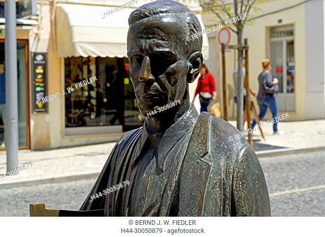 Seated statue of the popular poet Antonio Aleixo, in 1899-1949, Loulé Portugal