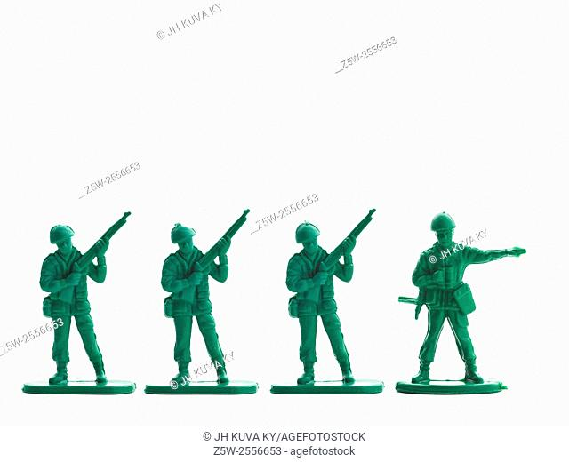 Several plastic soldiers in row, white background