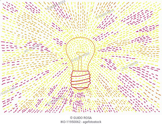 Light beams from glowing light bulb
