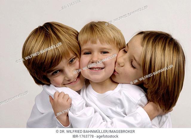 Three brothers, portrait, looking similar