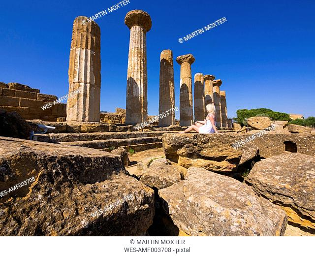 Italy, Sicily, Pillars at the temple of Hercules in front of blue sky