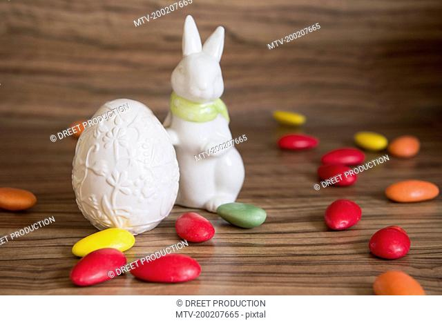Close-up of an Easter egg with Easter bunny and candies