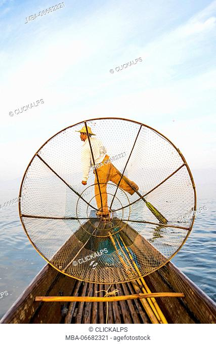 Inle lake, Nyaungshwe township, Taunggyi district, Myanmar (Burma). Local fisherman with typical conic fishing net