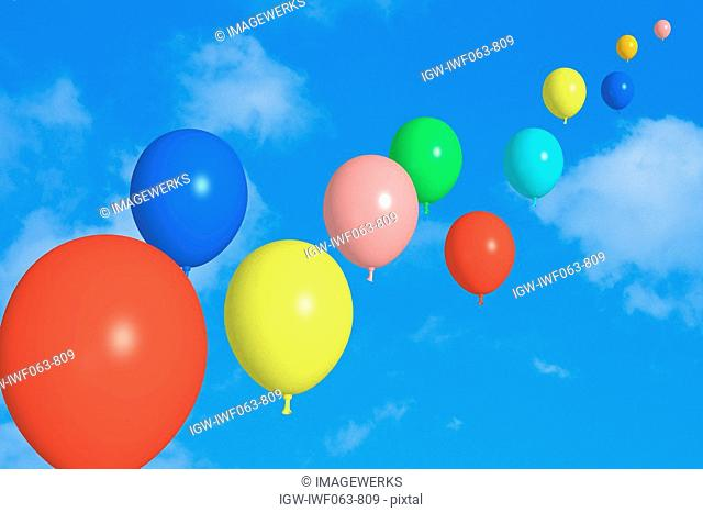 View of balloons against sky, close-up digital composite