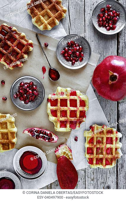 Fresh baked waffle with pomegranate jam, overhead shot