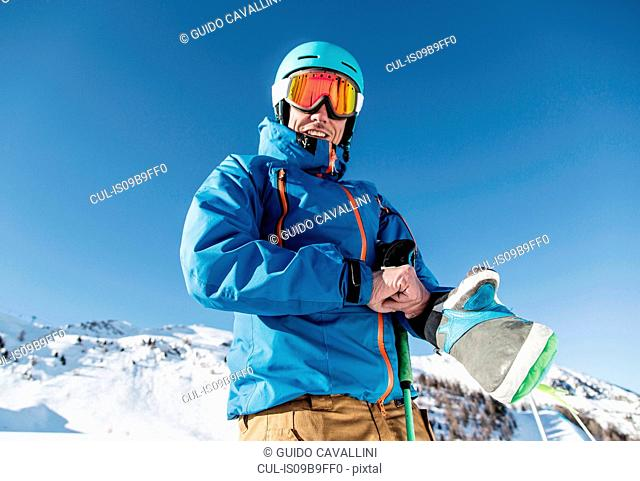 Portrait of skier in snow, low angle view