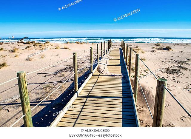 Empty beach with pathway in Costa Brava