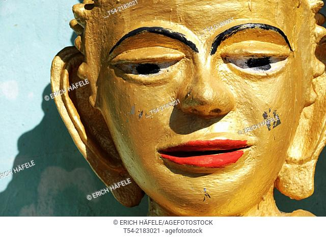Face of Buddha in a village temple