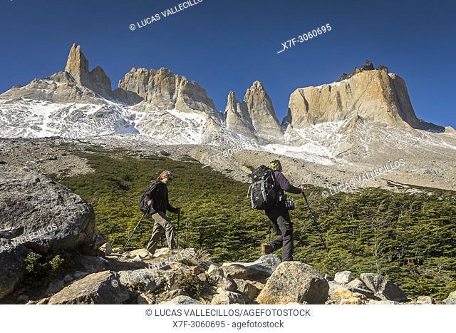 Hikers in Valle del Francés, in background from L to R Cerro Espada, Cerro Hoja, Cerro Mascara and the grand Cuerno Norte, PN Torres del Paine, Chile