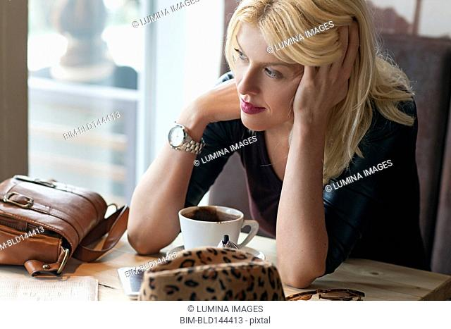 Woman sitting alone in cafe